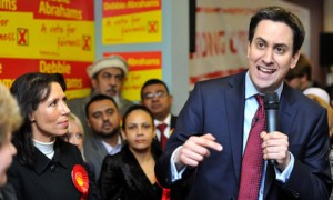Tomorrow belongs to them? Labour leader Ed Miliband, winning candidate Debbie Abrahams, and typical Oldham supporters.