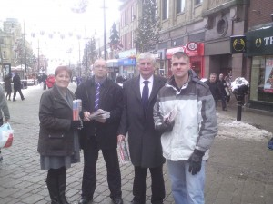 (left to right) Anita Corbett, a well known Oldham nationalist, was chosen by the local branch to be their by-election candidate, then ousted and smeared by Nick Griffin and his henchmen. Before her removal she canvassed Oldham town centre here with local organiser Jock Shearer, MEP Andrew Brons, and European parliamentary aide Chris Beverley.