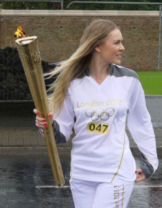 "TV presenter Zoe Salmon, seen here in Antrim with the Olympic flame, has spoken out against the snub to Northern Ireland in the naming of ""Team GB"""