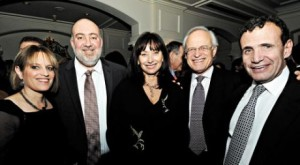Zionist tycoon Poju Zablodowicz (far right) with his wife (centre) and guests including then Israeli Ambassador Ron Prosor (second left), Mrs Prosor, and Martin Indyk (second right) Clinton's Ambassdor to Israel.  The photo was taken at a BICOM event in 2009 which raised £800,000.
