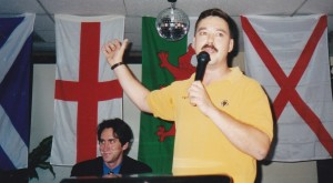 Mark Cotterill addressing an AF-BNP meeting in Arlington, Virginia in July 1999.  Vincent Breeding, then election campaign manager for David Duke is seated to his left.
