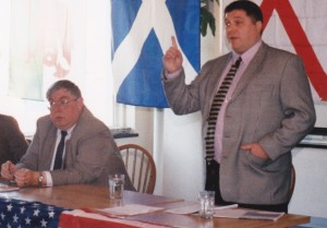 Stevie Cartwright addressing an AF-BNP meeting in Arlington, Virginia in March 1999.  Dr. Sam Francis, former columnist for the Washington Times is seated to his left.