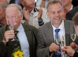 AfD's Mecklenburg-Vorpommern leader Leif-Erik Holm (right) celebrates with fellow campaigners including Brandenburg AfD chairman Alexander Gauland (left).