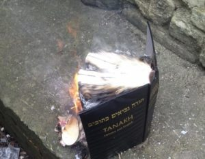 A Bible set alight by UKIP candidate Rabbi Shneur Odze, who posted the image online