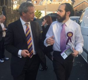UKIP's Rabbi Shneur Odze (right) canvassing for the party with then leader Nigel Farage.