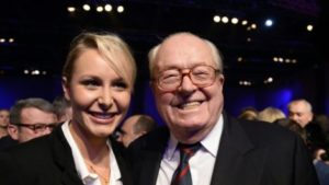 27-year-old Marion Maréchal Le Pen, seen here with her grandfather FN founder Jean-Marie Le Pen, stood down at this election and is temporarily withdrawing from politics after disagreements with her aunt Marine Le Pen.